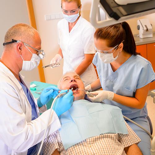 Dental Assistant arranging instruments and materials