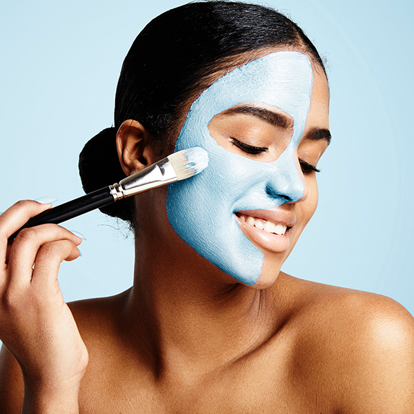 Esthetician applying skin treatment for acne and fine lines