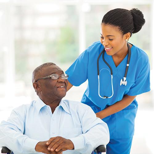 Nurse taking care of senior patient in wheelchair